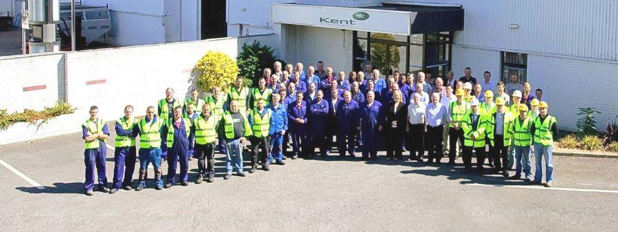 Photo of entire Kent team outside Kents factory