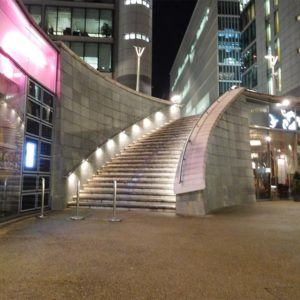 Kents curved LED spotlight handrail illuminating a staircase at night