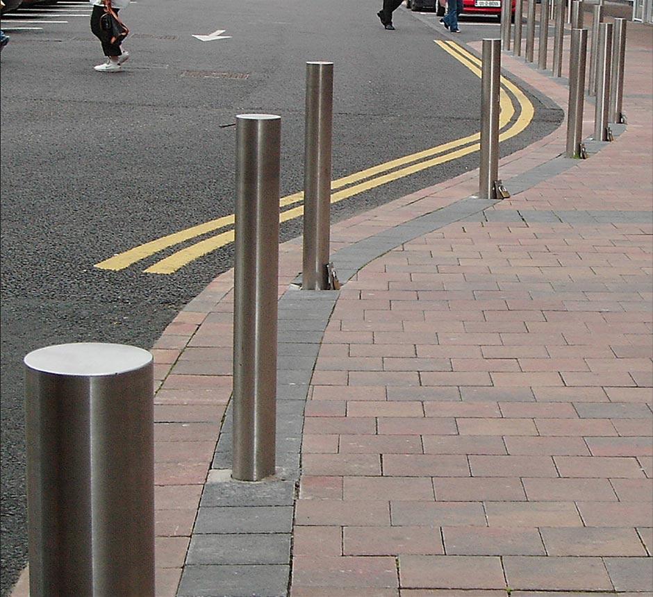 A row of Kents flat top bollards on a street