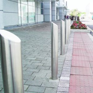 A row of Kents slope top bollards on a street