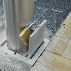 Close up of Kents padlock flip bollard socket with a lock