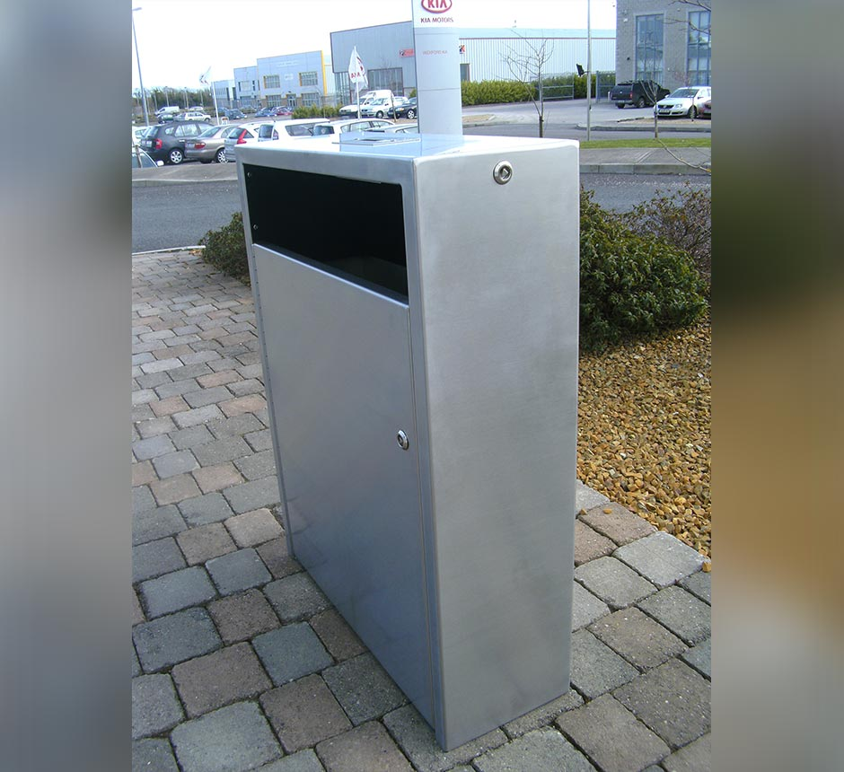 Side angle view of Kents Arsenal litter bin on a street
