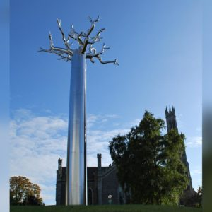 Kents medusa tree sculpture near a cathedral