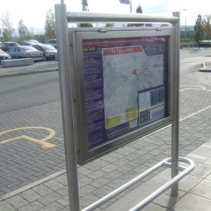 Street view of a light rail notice board by Kent